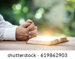 human hand placed on the bible  ... | Shutterstock . vector #619862903