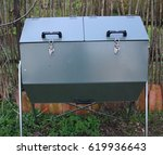 Small photo of The rotary composter. Insulated rotary composter, which allows hot composting in the garden throughout the year. Compost aerate rotation. A great utility in organic gardening and organic fertilizing.
