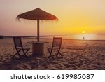 wooden table and chairs with... | Shutterstock . vector #619985087