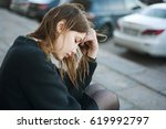 young sad woman sitting on the... | Shutterstock . vector #619992797