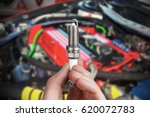 mechanic holds a spare part... | Shutterstock . vector #620072783