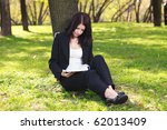 young businesswoman sitting on... | Shutterstock . vector #62013409