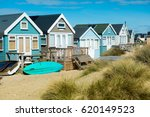 Beach Huts And Boats  At...