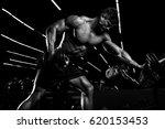 bodybuilder in the gym doing... | Shutterstock . vector #620153453