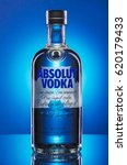 Small photo of KWIDZYN, POLAND - MARCH 29, 2017: Absolut vodka on blue background. Absolut vodka has been produced in southern Sweden since 1879. Absolut was bought by Pernod Ricard group in 2008