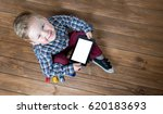 boy using tablet and laptop... | Shutterstock . vector #620183693