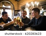 three happy young men in casual ... | Shutterstock . vector #620283623