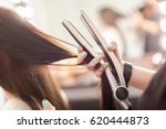 hairdresser does hair style of... | Shutterstock . vector #620444873