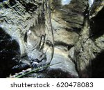 Small photo of This macro photography of ice gives the illusion of penetrating a secret cryptic cavern (Saguenay Fjord, Quebec).