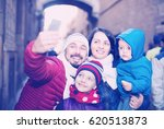 happy family of four doing... | Shutterstock . vector #620513873