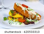 baked fish with vegetables on... | Shutterstock . vector #620533313