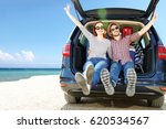 summer trip on beach by car and ... | Shutterstock . vector #620534567