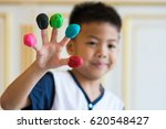 asian boy show doh color on his ... | Shutterstock . vector #620548427