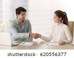 Small photo of Smiling businessman handshaking with young businesswoman before office meeting or discussion, starting teamwork on project, interesting acquaintance, beginning of the course