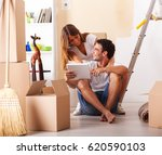young couple moving in their... | Shutterstock . vector #620590103