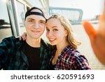 lovely hipster couple taking... | Shutterstock . vector #620591693