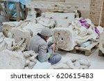 restorer fixes white marble...   Shutterstock . vector #620615483