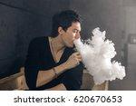 vaping man holding a mod. a...   Shutterstock . vector #620670653