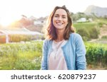 cheerful mature woman enjoying... | Shutterstock . vector #620879237