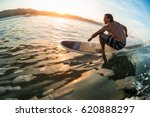 young man surfs the ocean wave... | Shutterstock . vector #620888297
