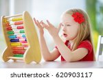 cute little girl playing with... | Shutterstock . vector #620903117