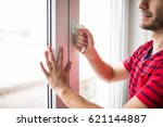 man is opening the window at... | Shutterstock . vector #621144887
