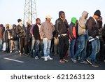 asylum seekers wait to leave... | Shutterstock . vector #621263123