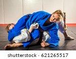 judo  jiu jitsu. two women are...   Shutterstock . vector #621265517