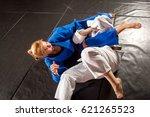 judo  jiu jitsu. two women are... | Shutterstock . vector #621265523