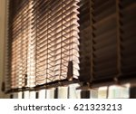 blinds in a home catching the... | Shutterstock . vector #621323213
