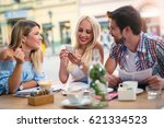 group of young friends laughing ... | Shutterstock . vector #621334523