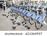 Small photo of April 15 2017-Shaw Go bike rentals,Pigeons and people in downtown Vancouver,BC Canada