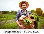 nice young farmer with freshly... | Shutterstock . vector #621435623