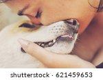 Stock photo latin woman love pet dog 621459653