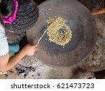 girl roasting traditional coffee | Shutterstock . vector #621473723
