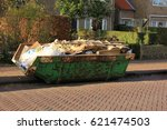 loaded dumpster near a... | Shutterstock . vector #621474503