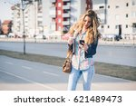 cute girl with a cup of coffee... | Shutterstock . vector #621489473