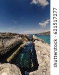 Small photo of Italy, Calabria, Tyrrhenian Sea, Briatico (Vibo Valentia Province), St. Irene rock, used by Romans as fish vasks (Murenario) - FILM SCAN