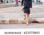 business woman walking across... | Shutterstock . vector #621575843
