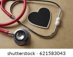 red stethoscope and black heart ... | Shutterstock . vector #621583043
