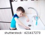 boy cleaning in bathroom wash... | Shutterstock . vector #621617273