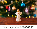 christmas angel on a wooden... | Shutterstock . vector #621654953