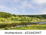 rural landscape with village on ... | Shutterstock . vector #621662447