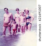 Small photo of USSR, ABKHAZIA, LESELIDZE - CIRCA 1980: Vintage photo of happy soviet family Tsyukevitch vacation on Black sea beach in Abkhazia, USSR