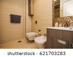 the toilet in the bathroom. the ... | Shutterstock . vector #621703283
