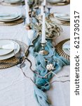 table setting  plates on the... | Shutterstock . vector #621730517