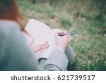 redhead girl sitting on green... | Shutterstock . vector #621739517
