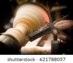 wood turning on a lathe at a... | Shutterstock . vector #621788057