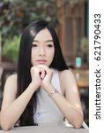 Small photo of Portrait of young beautiful black long hair absent-minded Asian Business woman looking outside in the cafe park with lonely emotional (shallow depth of field)