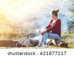 girl sitting on the log  and... | Shutterstock . vector #621877217